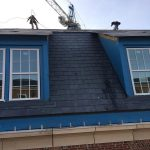 workers working on roof at UGA Business Learning Community